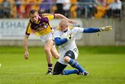 10 June 2012; Damien Sheridan, Longford, in action against Redmond Barry, Wexford. Leinster GAA Football Senior Championship, Quarter-Final Replay, Longford v Wexford, O'Connor Park, Tullamore, Co. Offaly. Picture credit: Barry Cregg / SPORTSFILE