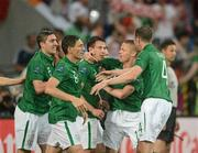 10 June 2012; Republic of Ireland's Sean St. Ledger, centre, celebrates with team-mates, from left to right, Stephen Ward, Keith Andrews, Damien Duff and John O'Shea, after scoring his side's equalising goal after 19 minutes. EURO2012, Group C, Republic of Ireland v Croatia, Municipal Stadium Poznan, Poznan, Poland. Picture credit: David Maher / SPORTSFILE