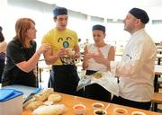 11 June 2012; Wagamama head chef Juan Mantaca, and Sharon Madigan, left, Nutritionist at the Irish Institute of Sport, speaking to Irish Olympic athletes, Eanna Bailey, modern pentathlon, and Caitriona Jennings, athletics, on how to prepare for the Olympics and Paralympics by learning to prepare healthy food during a Wagamama 'Positive Eating' Cooking Class in Wagamama, Blanchardstown, Co. Dublin. Picture credit: Brendan Moran / SPORTSFILE