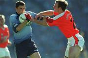 1 September 2002; Alan Brogan, Dublin, is tackled by Enda McNulty, Armagh. Dublin v Armagh, All Ireland Football Semi - Final, Croke Park, Dublin. Picture credit; Ray McManus / SPORTSFILE