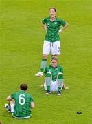 16 June 2012; Republic of Ireland players Shannon Smyth, left, Yvonne Tracy, standing, and Ciara Grant, show their disappointment after defeat to Wales. Women's European Championship Qualifier, Republic of Ireland v Wales, Turner's Cross, Cork. Picture credit: Diarmuid Greene / SPORTSFILE