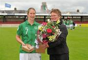16 June 2012; Ciara Grant, Republic of Ireland, is presented with her 100th cap and a bouquet of flowers before the game by Niamh O'Donoghue, Chairperson of the WFAI. Women's European Championship Qualifier, Republic of Ireland v Wales, Turner's Cross, Cork. Picture credit: Diarmuid Greene / SPORTSFILE