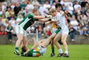 17 June 2012; Tomas O'Connor, Kildare, tussels with Offaly players, from left, Alan Mulhall, Shane Sullivan and Richie Dalton. Leinster GAA Football Senior Championship Quarter-Final, Offaly v Kildare, O'Moore Park, Portlaoise, Co. Laois. Picture credit: Matt Browne / SPORTSFILE