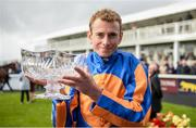 10 September 2017; Ryan Moore celebrates with the trophy after winning the Comer Group International Irish St Leger on Order of St George during the Longines Irish Champions Weekend 2017 at The Curragh Racecourse in Co Kildare. Photo by Cody Glenn/Sportsfile
