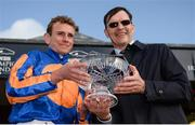 10 September 2017; Jockey Ryan Moore and trainer Aidan O'Brien celebrate with the trophy after winning the Comer Group International Irish St Leger on Order of St George during the Longines Irish Champions Weekend 2017 at The Curragh Racecourse in Co Kildare. Photo by Cody Glenn/Sportsfile