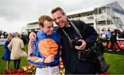 10 September 2017; Ryan Moore congratulated by photographer Pat Healy after winning the Comer Group International Irish St Leger on Order of St George during the Longines Irish Champions Weekend 2017 at The Curragh Racecourse in Co Kildare. Photo by Cody Glenn/Sportsfile