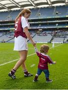 10 September 2017; Westmeath's Elaine Finn with her son Liam, 19 months, after the Liberty Insurance All-Ireland Premier Junior Camogie Championship Final match between Dublin and Westmeath at Croke Park in Dublin. Photo by Piaras Ó Mídheach/Sportsfile
