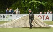 13 September 2017; Covers are brought onto the pitch before the One Day International match between Ireland and West Indies was cancelled due to a wet pitch, at Stormont in Belfast. Photo by Piaras Ó Mídheach/Sportsfile