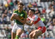 17 September 2017; David Clifford of Kerry is tackled by Conor McCluskey of Derry on his way to score a goal in the first minute of the Electric Ireland GAA Football All-Ireland Minor Championship Final match between Kerry and Derry at Croke Park in Dublin. Photo by Ray McManus/Sportsfile