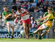 17 September 2017; Callum Brown of Derry is tackled by Seán O'Leary of Kerry , left, and goalkeeper Deividas Uosis which resulted in a penalty being awarded, to Derry, during the Electric Ireland GAA Football All-Ireland Minor Championship Final match between Kerry and Derry at Croke Park in Dublin. Photo by Ray McManus/Sportsfile