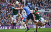 17 September 2017; James McCarthy of Dublin in action against Donal Vaughan, left, and Aidan O'Shea of Mayo during the GAA Football All-Ireland Senior Championship Final match between Dublin and Mayo at Croke Park in Dublin. Photo by Eóin Noonan/Sportsfile