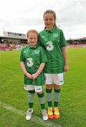 16 June 2012; Mascots, and nieces of Ciara Grant, Aoife Grant, aged 8, left, and Stephanie Grant, aged 12, both from Waterford, before the game. Women's European Championship Qualifier, Republic of Ireland v Wales, Turner's Cross, Cork. Picture credit: Diarmuid Greene / SPORTSFILE
