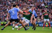 17 September 2017; Lee Keegan of Mayo gets his shot away despite the attentions of Cian O'Sullivan and Ciarán Kilkenny of Dublin during the GAA Football All-Ireland Senior Championship Final match between Dublin and Mayo at Croke Park in Dublin. Photo by Sam Barnes/Sportsfile