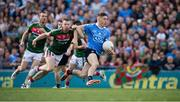 17 September 2017; Con O'Callaghan of Dublin evades the tackle of Colm Boyle, 7, and Keith Higgins of Mayo on his way to scoring his side's goal in the first minute of the GAA Football All-Ireland Senior Championship Final match between Dublin and Mayo at Croke Park in Dublin. Photo by Ray McManus/Sportsfile