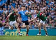 17 September 2017; Con O'Callaghan of Dublin evades the tackle of Colm Boyle, left, and Keith Higgins of Mayo on his way to scoring his side's goal in the first minute of the GAA Football All-Ireland Senior Championship Final match between Dublin and Mayo at Croke Park in Dublin. Photo by Ray McManus/Sportsfile