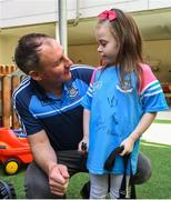 18 September 2017; Dublin manager Jim Gavin with Dublin supporter Lacey Robinson, aged 5, from Clondalkin, Co. Dublin during the All-Ireland Senior Football Champions visit to Our Lady's Children's Hospital in Crumlin, Dublin. Photo by David Fitzgerald/Sportsfile