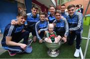 18 September 2017; Dublin players, from left, Evan Comerford, Brian Howard, Eoin Murchan, Philip McMahon, Michael Fitzsimons, Mark Schutte and Cillian O'Shea pictured with Mayo supporter Cathal Downey, aged 4, from Co Kildare and the Sam Maguire Cup during the All-Ireland Senior Football Champions visit to Our Lady's Children's Hospital in Crumlin, Dublin. Photo by David Fitzgerald/Sportsfile