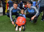 18 September 2017; Dublin players Mark Schutte, left, and Michael Fitzsimons pictured with Dublin supporter Milana Commons, aged 3, from Dublin and the Sam Maguire Cup during the All-Ireland Senior Football Champions visit to Our Lady's Children's Hospital in Crumlin, Dublin. Photo by David Fitzgerald/Sportsfile