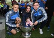 18 September 2017; Dublin players Eoin Murchan, left, and Cillian O'Shea pictured with Freya Ruth, aged 8 months, from Tallaght, Dublin and her mother Leah during the All-Ireland Senior Football Champions visit to Our Lady's Children's Hospital in Crumlin, Dublin. Photo by David Fitzgerald/Sportsfile