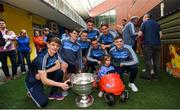 18 September 2017; Dublin players, from left, Evan Comerford, Brian Howard, Eoin Murchan, Erin Lowndes, Mark Schutte, Michael Fitzsimons and Cillian O'Shea pictured with Dublin supporter Milana Commons, aged 3, from Dublin and the Sam Maguire Cup during the All-Ireland Senior Football Champions visit to Our Lady's Children's Hospital in Crumlin, Dublin. Photo by David Fitzgerald/Sportsfile