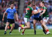17 September 2017; Ciarán Kilkenny of Dublin is tackled by Lee Keegan, left, and Donal Vaughan of Mayo during the GAA Football All-Ireland Senior Championship Final match between Dublin and Mayo at Croke Park in Dublin. Photo by Stephen McCarthy/Sportsfile