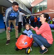 18 September 2017; Dublin player James McCarthy pictured with Dublin supporter Milana Commons, aged 3, from Dublin and her mother Victoria during the All-Ireland Senior Football Champions visit to Our Lady's Children's Hospital in Crumlin, Dublin. Photo by David Fitzgerald/Sportsfile