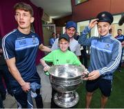 18 September 2017; Dublin players Evan Comerford, left, and Eoin Murchan pictured with Dylan Hennessy, aged 11, from Ashbourne, Co Meath and his father Warren during the All-Ireland Senior Football Champions visit to Our Lady's Children's Hospital in Crumlin, Dublin. Photo by David Fitzgerald/Sportsfile