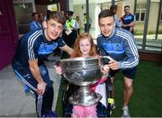 18 September 2017; Dublin players Evan Comerford, left, and Eoin Murchan pictured with Aine McCarthy, aged 11, from Celbridge, Co Kildare and the Sam Maguire Cup during the All-Ireland Senior Football Champions visit to Our Lady's Children's Hospital in Crumlin, Dublin. Photo by David Fitzgerald/Sportsfile