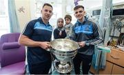 18 September 2017; Dublin footballers Philly McMahon, left, and Cillian O'Shea with Jafar Ahmed, age 3, with his mother Zainab during the All-Ireland Senior Football Champions visit to Temple Street Children's Hospital in Dublin. Photo by Piaras Ó Mídheach/Sportsfile