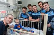 18 September 2017; Dublin footballers, from left, Eric Lowndes, Evan Comerford, Philly McMahon, Mark Schutte and Cillian O'Shea with Dara Cahill, age 9 months, with dad Brian, from Clontarf, during the All-Ireland Senior Football Champions visit to Temple Street Children's Hospital in Dublin. Photo by Piaras Ó Mídheach/Sportsfile
