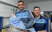 18 September 2017; Dublin footballers James McCarthy, left, and Philly McMahon with Conal Barker-Keogh, 16 days old, from Mulhuddart in Dublin, during the All-Ireland Senior Football Champions visit to Temple Street Children's Hospital in Dublin. Photo by Piaras Ó Mídheach/Sportsfile
