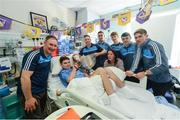18 September 2017; Dublin manager Jim Gavin and players with Rory Whelan and his mother Helen, from New Ross, Co Wexford, during the All-Ireland Senior Football Champions visit to Temple Street Children's Hospital in Dublin. Photo by Piaras Ó Mídheach/Sportsfile