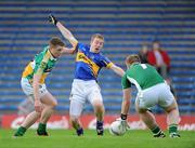 30 June 2012; Brian Fox, Tipperary, in action against Nigel Dunne, left, and Alan Mulhall, Offaly. GAA Football All-Ireland Senior Championship Qualifier Round 1, Tipperary v Offaly, Semple Stadium, Thurles, Co. Tipperary. Picture credit: Ray Lohan / SPORTSFILE