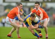 1 July 2012; Colin Compton, Roscommon, in action against Andy Mallon, left, and Aidan Forker, Armagh. GAA Football All-Ireland Senior Championship Qualifier Round 1, Roscommon v Armagh, Dr. Hyde Park, Co. Roscommon. Picture credit: Barry Cregg / SPORTSFILE