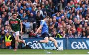 17 September 2017; Dean Rock of Dublin kicks his side's winning point, a free, as Lee Keegan of Mayo watches on during the GAA Football All-Ireland Senior Championship Final match between Dublin and Mayo at Croke Park in Dublin. Photo by Stephen McCarthy/Sportsfile