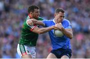 17 September 2017; Dean Rock of Dublin is tackled by Chris Barrett of Mayo during the GAA Football All-Ireland Senior Championship Final match between Dublin and Mayo at Croke Park in Dublin. Photo by Ramsey Cardy/Sportsfile