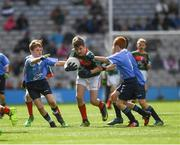 17 September 2017; Michael Henry, St. Oliver Plunkett B.N.S., Moate, Co Westmeath, representing Mayo, in action against James Cranny, Bennekerry National School, Bennekerry, Co Carlow, representing Dublin, and James Cranny, Bennekerry National School, Bennekerry, Co Carlow, representing Dublin, during the INTO Cumann na mBunscol GAA Respect Exhibition Go Games at Dublin v Mayo GAA Football All-Ireland Senior Championship Final at Croke Park in Dublin. Photo by Ray McManus/Sportsfile