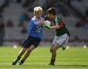 17 September 2017; Cillian Byrne, Poulfur National School, New Ross, Co. Wexford, representing Dublin, in action against Martin Kirk, St. Finloughs PS, Limavady, Co. Derry, representing Mayo, during the INTO Cumann na mBunscol GAA Respect Exhibition Go Games at Dublin v Mayo GAA Football All-Ireland Senior Championship Final at Croke Park in Dublin. Photo by Ray McManus/Sportsfile
