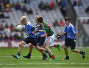 17 September 2017; Cillian Byrne, Poulfur National School, New Ross, Co. Wexford, representing Dublin, Roy Murphy, De La Salle NS, Ballyfermot Road, Dublin, representing Dublin, and Bryan Hayes, St. Anthony's Boys NS, Ballinlough, Co. Cork, representing Dublin, in action against Liam O'Connor, C.B.S. Primary School, Dundalk, Co. Louth, representing Mayo, during the INTO Cumann na mBunscol GAA Respect Exhibition Go Games at Dublin v Mayo GAA Football All-Ireland Senior Championship Final at Croke Park in Dublin. Photo by Ray McManus/Sportsfile