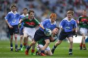17 September 2017; James Cranny, Bennekerry National School, Bennekerry, Co. Carlow, representing Dublin, Ruairí McCullagh, right,  St. Teresa's P.S., Loughmacrory, Omagh, Co. Tyrone, representing Dublin, and in action against Martin Kirk, left, St. Finloughs PS, Limavady, Co. Derry, representing Mayo, and Ryan Byrne, Cloontuskert NS, Cloontuskert, Lanesboro, Co. Roscommon, representing Mayo, during the INTO Cumann na mBunscol GAA Respect Exhibition Go Games at Dublin v Mayo GAA Football All-Ireland Senior Championship Final at Croke Park in Dublin. Photo by Ray McManus/Sportsfile