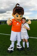 14 September 2017; Aisling Keady, age 10, of Cavan Shamrocks, with Aviva Soccer Sisters mascot Cara during the Aviva Soccer Sisters Golden Camp. Forty girls from the Aviva 'Soccer Sisters' initiative were given the opportunity of a lifetime, as they took part in a special training session alongside several members of the Republic of Ireland women's senior team. The girls were selected from over 4,000 budding footballers between the ages of seven and 12 to take part in the special session at the FAI National Training Centre, as part of the 2017 Aviva Soccer Sisters Golden Camp. The Camp saw the girls sit in on a full Irish team training session, before taking to the field with the team ahead of next Tuesday's FIFA World Cup Qualifier against Northern Ireland. The Aviva Soccer Sisters programme has been running since 2010 and is aimed at engaging young girls in physical exercise and attracting them to the game of football. Over 30,000 girls have taken part in the programme since it first kicked off, including Roma McLaughlin who is part of Colin Bell's line-up for next week's qualifier.  For further information on Aviva Soccer Sisters, visit: www.aviva.ie/soccersisters  #AvivaSoccerSisters. FAI National Training Centre, Abbotstown, Dublin. Photo by Stephen McCarthy/Sportsfile