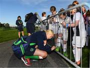 14 September 2017; Stephanie Roche of the Republic of Ireland women's national team signs an autogrpah for Emma Maher, age 8, from Laois, during the Aviva Soccer Sisters Golden Camp. Forty girls from the Aviva 'Soccer Sisters' initiative were given the opportunity of a lifetime, as they took part in a special training session alongside several members of the Republic of Ireland women's senior team. The girls were selected from over 4,000 budding footballers between the ages of seven and 12 to take part in the special session at the FAI National Training Centre, as part of the 2017 Aviva Soccer Sisters Golden Camp. The Camp saw the girls sit in on a full Irish team training session, before taking to the field with the team ahead of next Tuesday's FIFA World Cup Qualifier against Northern Ireland. The Aviva Soccer Sisters programme has been running since 2010 and is aimed at engaging young girls in physical exercise and attracting them to the game of football. Over 30,000 girls have taken part in the programme since it first kicked off, including Roma McLaughlin who is part of Colin Bell's line-up for next week's qualifier.  For further information on Aviva Soccer Sisters, visit: www.aviva.ie/soccersisters  #AvivaSoccerSisters. FAI National Training Centre, Abbotstown, Dublin. Photo by Stephen McCarthy/Sportsfile