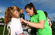 14 September 2017; Aoine O'Gorman of the Republic of Ireland women's national team signs an autograph for Katie Rigley, age 9, from  Irishtown, Dublin, during the Aviva Soccer Sisters Golden Camp. Forty girls from the Aviva 'Soccer Sisters' initiative were given the opportunity of a lifetime, as they took part in a special training session alongside several members of the Republic of Ireland women's senior team. The girls were selected from over 4,000 budding footballers between the ages of seven and 12 to take part in the special session at the FAI National Training Centre, as part of the 2017 Aviva Soccer Sisters Golden Camp. The Camp saw the girls sit in on a full Irish team training session, before taking to the field with the team ahead of next Tuesday's FIFA World Cup Qualifier against Northern Ireland. The Aviva Soccer Sisters programme has been running since 2010 and is aimed at engaging young girls in physical exercise and attracting them to the game of football. Over 30,000 girls have taken part in the programme since it first kicked off, including Roma McLaughlin who is part of Colin Bell's line-up for next week's qualifier.  For further information on Aviva Soccer Sisters, visit: www.aviva.ie/soccersisters  #AvivaSoccerSisters. FAI National Training Centre, Abbotstown, Dublin. Photo by Stephen McCarthy/Sportsfile