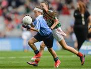 17 September 2017; Roisin Lynch, St Naul's NS, Inver, Co. Donegal, representing Dublin, in action against Sophie Daly, Annagh NS, Miltown Malbay, Co. Clare, representing Mayo, during the INTO Cumann na mBunscol GAA Respect Exhibition Go Games at Dublin v Mayo GAA Football All-Ireland Senior Championship Final at Croke Park in Dublin. Photo by Piaras Ó Mídheach/Sportsfile