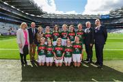 17 September 2017; President of the Ladies Football Association Marie Hickey, President of Cumann na mBunscol Liam McGee, Uachtarán Chumann Lúthchleas Gael Aogán Ó Fearghaíl, President of the INTO John Boyle, Referee Caoimhe McDaid, Belgrove GNS, Clontarf, Dublin 3, with the Mayo team, back row, left to right, Siofra McCreesh, Anamar PS, Crossmaglen, Co. Down, Hannah Brennan, Scoil Mhuire, Broadford, Co. Limerick, Ciara Hegarty, Corrandulla NS, Corrandulla, Co. Galway, Michaela Judge, St. Brigid's NS, Drumcong, Co. Leitrim, Freya Hardy, Petit-de-Mange, Gaelscoil Osrai, Loughboy, Cill Chainnigh, front row, left to right, Faye McEvoy, Scoil Eoin Phóil Naofa, Ballyroan, Co. Laois, Aoife Ní Standúin, Gaelscoil na Cruaiche, Cathair na Mart, Mhaig Eo, Ruby Mc Cleary, Bunscoil an tSléibhe Dhuibh, Béal Feirste, Aontroim, Grace Murtagh, Milltown NS, Milltown, Co. Kildare, Sophie Daly, Annagh NS, Miltown Malbay, Co. Clare, ahead of the INTO Cumann na mBunscol GAA Respect Exhibition Go Games at Dublin v Mayo GAA Football All-Ireland Senior Championship Final at Croke Park in Dublin. Photo by Daire Brennan/Sportsfile