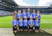 17 September 2017; Referee Caoimhe McDaid, Belgrove GNS, Clontarf, Dublin 3, with the Dublin team, back row, left to right, Ruby Coffey, Scoil Mhairtin, Kilworth, Co. Cork, Ciara Cummins, Danecastle NS, Carrig on Bannow, Co. Wexford, Keeva Gillen, St. Mel's NS, Ardagh, Co. Longford, Sophie Dennehy, Fossa NS, Killarney, Co. Kerry, Saoirse McGuinness, St. Manchan's NS, Tubber, Moate, Co. Westmeath, front row, left to right, Iseult Reilly, Scoil Mologa,, Harolds Cross, Clareville Road, Dublin, Niamh Rice, St Bronagh's PS, Rostrevor, Co. Down, Roisin Lynch, St Naul's NS, Inver, Co. Donegal, Maeve Lydon, Scoil Treasa, Firhouse, Dublin, Aobha Harmon, Rathcoyle NS, Rathdangan, Co. Wicklow, ahead of the INTO Cumann na mBunscol GAA Respect Exhibition Go Games at Dublin v Mayo GAA Football All-Ireland Senior Championship Final at Croke Park in Dublin. Photo by Daire Brennan/Sportsfile
