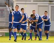 22 September 2017; Shane Tracy is congratulated by his Limerick team-mates after scoring their side's second goal during the SSE Airtricity League Premier Division match between Limerick FC and Cork City at Markets Fields in Limerick. Photo by Stephen McCarthy/Sportsfile