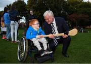 22 September 2017; Nathan Kiely, age 6, from Blanchardstown, learns more about hurling from Uachtarán Chumann Lúthchleas Gael Aogán Ó Fearghai at the GAA Fun & Run Launch at Culture Night at Trinity College Cricket Ground in Dublin. GAA Fun & Run is a specially designed programme which focuses upon the integration and inclusion of people with disabilities in Gaelic games, while also giving participants the opportunity to take part in 60 minutes of moderate to vigorous activity. Photo by Cody Glenn/Sportsfile