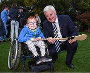 22 September 2017; Nathan Kiely, age 6, from Blanchardstown, learns more about hurling from Uachtarán Chumann Lúthchleas Gael Aogán Ó Fearghail at the GAA Fun & Run Launch at Culture Night at Trinity College Cricket Ground in Dublin. GAA Fun & Run is a specially designed programme which focuses upon the integration and inclusion of people with disabilities in Gaelic games, while also giving participants the opportunity to take part in 60 minutes of moderate to vigorous activity. Photo by Cody Glenn/Sportsfile