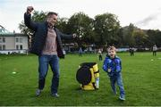 22 September 2017; Conor Grant, age 3, from Castleknock, Co Dublin, and his father Brian Grant take part during the GAA Fun & Run Launch at Culture Night at Trinity College Cricket Ground in Dublin. GAA Fun & Run is a specially designed programme which focuses upon the integration and inclusion of people with disabilities in Gaelic games, while also giving participants the opportunity to take part in 60 minutes of moderate to vigorous activity. Photo by Cody Glenn/Sportsfile